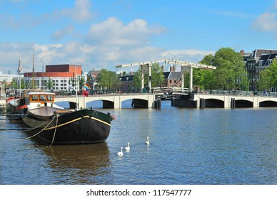 Amsterdam. Amstel river and the famous narrow Skinny Bridge