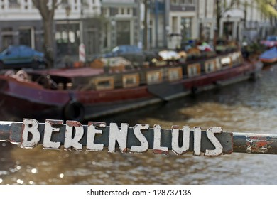 Amsterdam. Ancient inscription with the bridge name via the channel