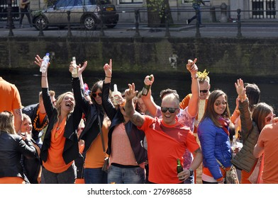 AMSTERDAM APR 27: The crowd of teenagers at the party during celebration Queensday in Amsterdam on April 27. 2015 in Holland