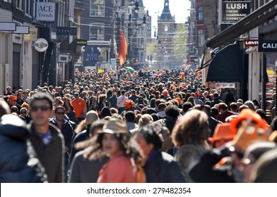 AMSTERDAM APR 27: People at the party during celebration Queensday in Amsterdam on April 27. 2015 in Holland