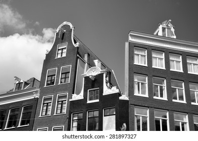 AMSTERDAM - APR 28: An old traditional oblique houses at the city centre in Amsterdam on April 28. 2015 in Netherlands. Black and white photo.