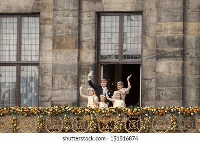 AMSTERDAM - APR 30:  King Willem-Alexander, Queen Maxima and children waves from the balcony of the palace after the accession of the throne on April 30, 2013 in Amsterdam.