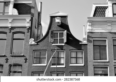 AMSTERDAM - APR 30: An old traditional oblique houses at the city centre in Amsterdam on April 30. 2015 in Netherlands - Black and white photo