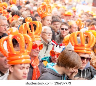 AMSTERDAM - APR 30: Thousands of city natives and tourists circle through Dam Square after the royal inauguration and speech of King Willem-Alexander, April 30, 2013, Amsterdam, The Netherlands