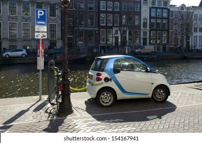 AMSTERDAM - APRIL 1: Electric car on april 1, 2013 in amsterdam. Car2go has 300 electric cars for rent in the city. Also they offer free parking in special car parks and at the loading points