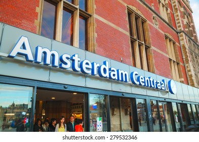 AMSTERDAM - APRIL 16: Entrance to the Amsterdam Centraal railway station on April 16, 2015 in Amsterdam, Netherlands. It's is the largest railway station of Amsterdam and a major national railway hub.