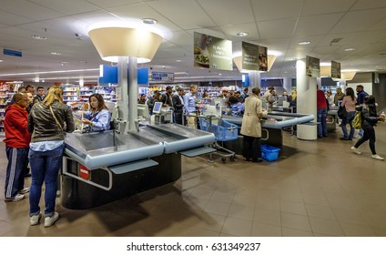 Amsterdam, April 2017. People queuing at the checkout counter of a supermarket to pay their groceries