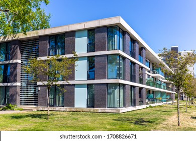 Amsterdam, April 2020. Modern three story apartment block with lots of glass and balconies