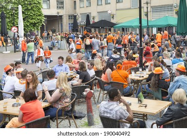 AMSTERDAM - APRIL 26: City natives and tourists celebrate King's Day, Dutch annual national holiday, at the city's Max Euwe Square, on April 26, 2014 in Amsterdam, The Netherlands