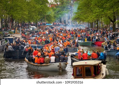 AMSTERDAM - APRIL 27, 2018: Huge traffic at Amsterdam channels during the Kingsday 2018 celebrations.