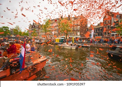AMSTERDAM - APRIL 27, 2018: Kingsday celebrations at Amsterdam channels during the Kingsday 2018.