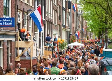 AMSTERDAM - APRIL 27, 2018: Kingsday celebrations at Amsterdam street during the Kingsday 2018.