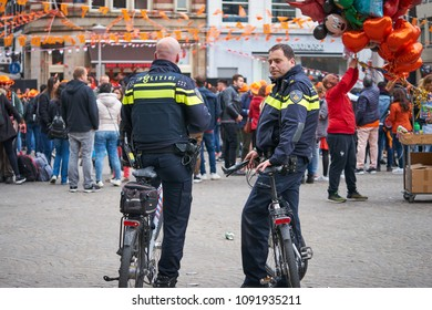 AMSTERDAM - APRIL 27, 2018: Police patrol on the bikes during the Kingsday 2018 celebrations in Amsterdam.