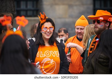 AMSTERDAM - APRIL 27, 2018: Woman in orange costume during the Kingsday 2018 celebrations in Amsterdam.