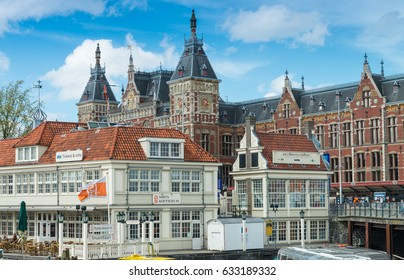 AMSTERDAM - APRIL 30, 2013: Tourists in city center for Queensday. More than 5 million people visit Amsterdam every year.