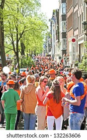 AMSTERDAM - APRIL 30: Big crowds in orange from people partying in the streets during the celebration of queensday on April 30, 2012 in Amsterdam, The Netherlands