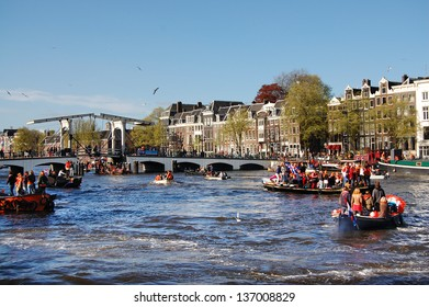 AMSTERDAM - APRIL 30: Celebration of queensday on the Amstel river on April 30, 2013 in Amsterdam, The Netherlands