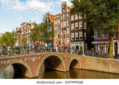 AMSTERDAM - AUGUST 1, 2017: Bridge in Amsterdam, the capital of Netherlands and a popular touristic destination