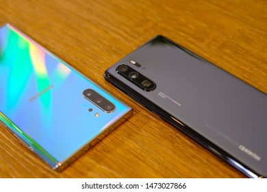 AMSTERDAM, AUGUST 2, 2019 - Newly launched Samsung Galaxy Note 10+  smartphone is displayed for editorial purposes alongside Huawei P30 Pro