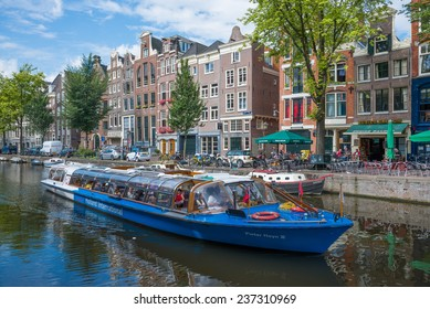 AMSTERDAM - AUGUST 4: Typical landscape with roads and canals of the city center on august 4, 2014 in Amsterdam