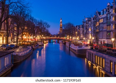 Amsterdam, Beautiful twilight time, Blue hours with a view of Western church from Prinsengracht canal, Netherlands.