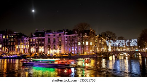 Amsterdam by night during light festival: water colors.
