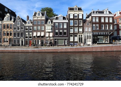 Amsterdam canal architecture - Prinsengracht canal rowhouses in De Wallen district.