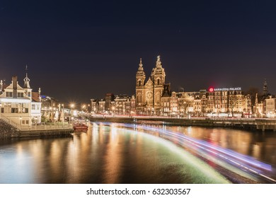 Amsterdam canal Central Damrak long exposure shot with passenger boat lights, Amsterdam Netherlands March 2017