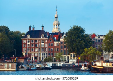 Amsterdam canal with typical dutch houses and church Zuiderkerk, Holland, Netherlands.