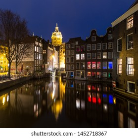 Amsterdam Canals and Saint Nicholas church sunset Netherlands