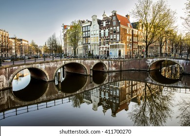 Amsterdam canals UNESCO intersection Keizersgracht and Leidsegracht beautiful old typical canal houses after sunrise