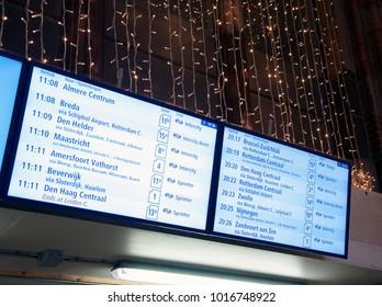 Amsterdam central station. Train time information display. Amsterdam. Netherlands. December 2017.