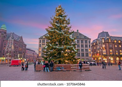 Amsterdam at christmas time on the Dam square in the Netherlands at sunset