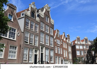 Amsterdam city architecture - Begijnhof residential buildings. Netherlands rowhouse.