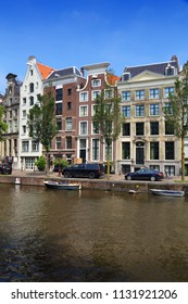 Amsterdam city architecture - Keizersgracht canal residential buildings. Netherlands rowhouse.