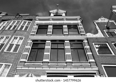 Amsterdam city architecture - Oude Turfmarkt residential buildings. Netherlands rowhouse. Black and white vintage style.