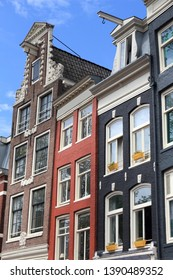 Amsterdam city architecture - Oudezijs Voorburgwal residential buildings. Netherlands rowhouse.