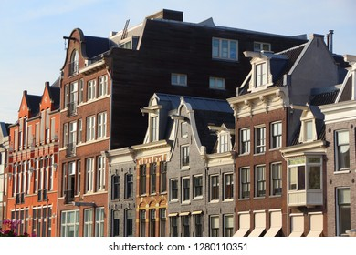 Amsterdam city architecture - Prinsengracht residential buildings. Netherlands rowhouse.