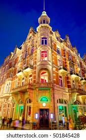 Amsterdam city center illuminated at night