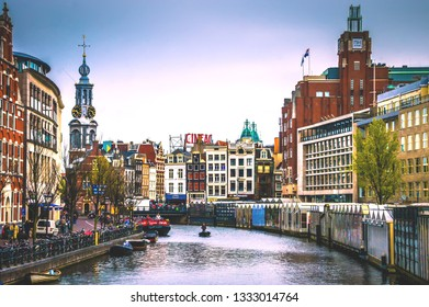 Amsterdam city. Famous Dutch channels and great cityscape. Colorful morning scene of Netherlands. Traveling concept background. city skyline at canal waterfront -Amsterdam,Netherlands, 3 July 2018