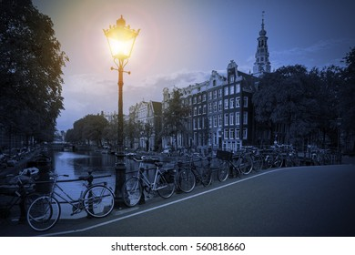 Amsterdam cityscape in blue with a street lantern at the famous Kloveniersburgwal canal and the Southern Church in the Netherlands