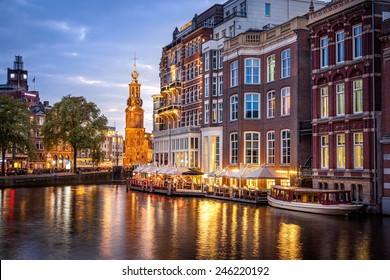 Amsterdam clock tower is one of attractions near the flower market  in Amsterdam, Netherlands.