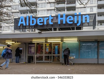 Amsterdam, December 2016: A few customers outside of a branch of Albert Heijn, the biggest Dutch Supermarket chain