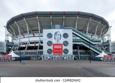 Amsterdam, December 2016. Outside view of the Johan Cruijff Arena soccer stadium, home of the Ajax team, with a big portrait of Cruijff over the entrance