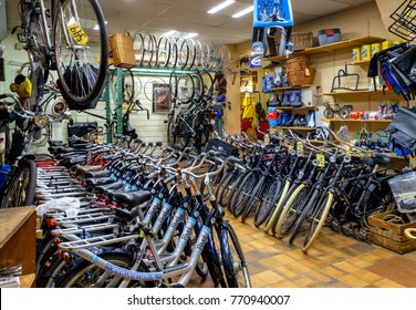 Amsterdam, December 2017. Interior of a small bicycle shop with many new and used bicycles and all sorts of bicycle parts