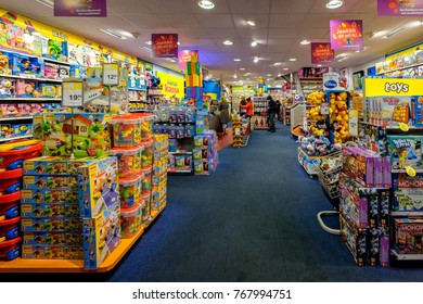 Amsterdam, December 2017. Interior of a toy shop of the Intertoys chain, with customers in the background