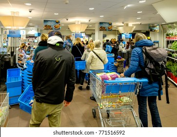 Amsterdam, December 2017. People waiting in the queue at the checkout counter of a supermarket