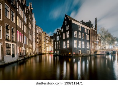 Amsterdam at dusk, bluidligs and canal crossroads. Netherlands