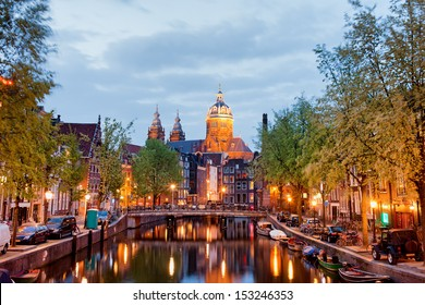 Amsterdam at dusk in Netherlands, North Holland province.