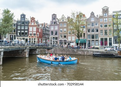 Amsterdam dutch canals and boats with narrow Streets and canals of Amsterdam central , Amsterdam Netherlands July 2017